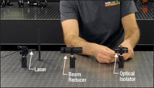 The DIY beam reducer shown in place between the laser and the free-space isolator.